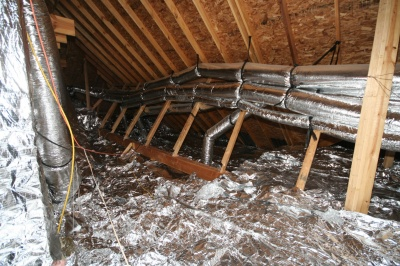 Radiant Barrier Foil shown over attic insulation